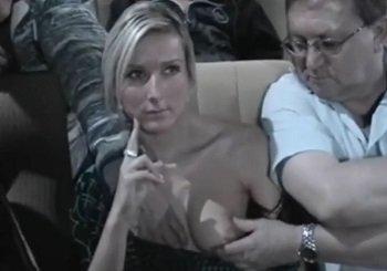 映画館で上映中に彼氏が隣にいるのに痴漢されて黙ってる巨乳美女